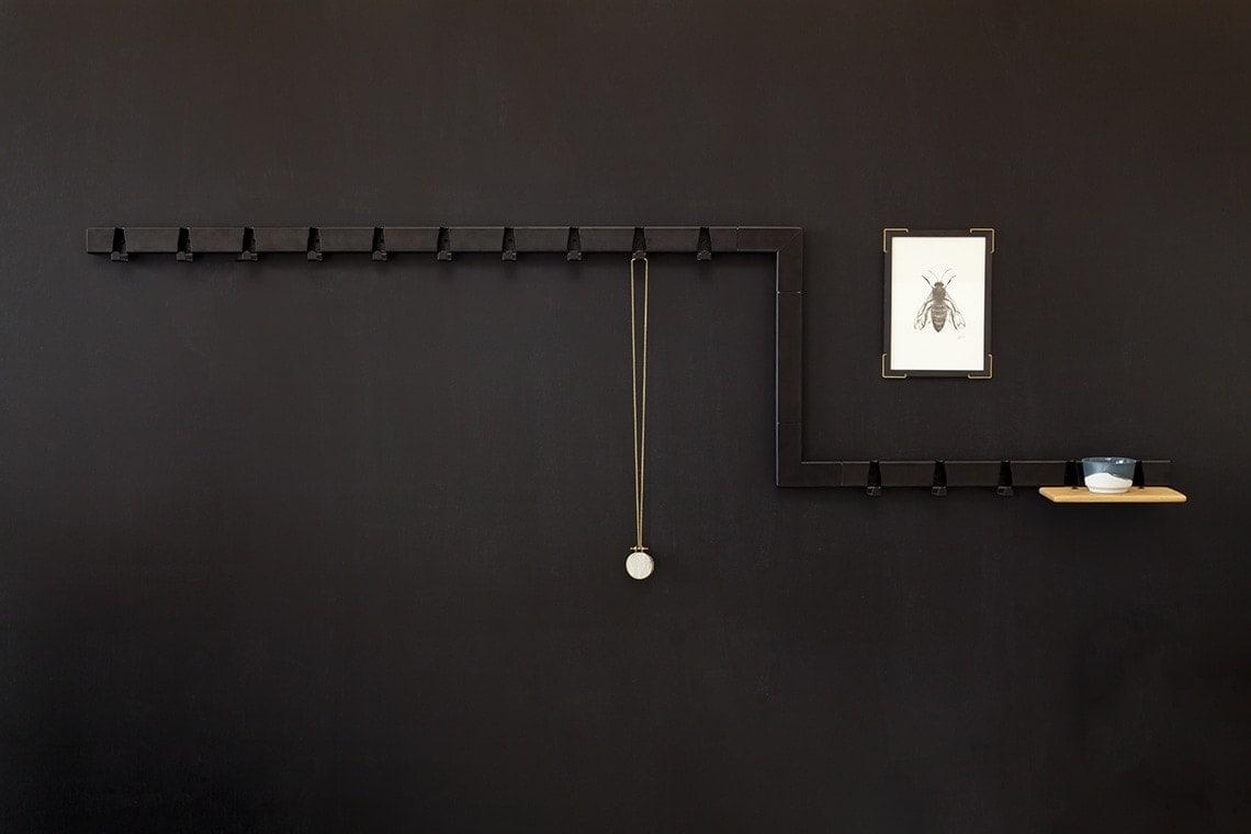 vij5 showroom black coatrack black wall 2017 image by vij5